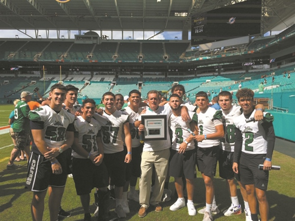 Hialeah Gardens, Greg Magner honored at Dolphins game