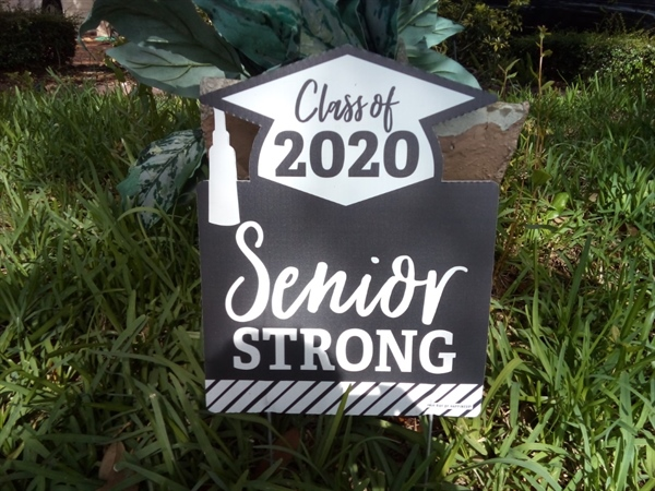 Signs for grads bring complaints
