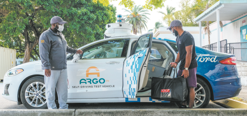 A Ford Fusion hybrid car that uses Argo AI self-driving technology delivers food and school supplies to kids learning from home during the coronavirus pandemic, a project of The Education Fund, which is based in Miami Lakes. Photos courtesy of The Ed
