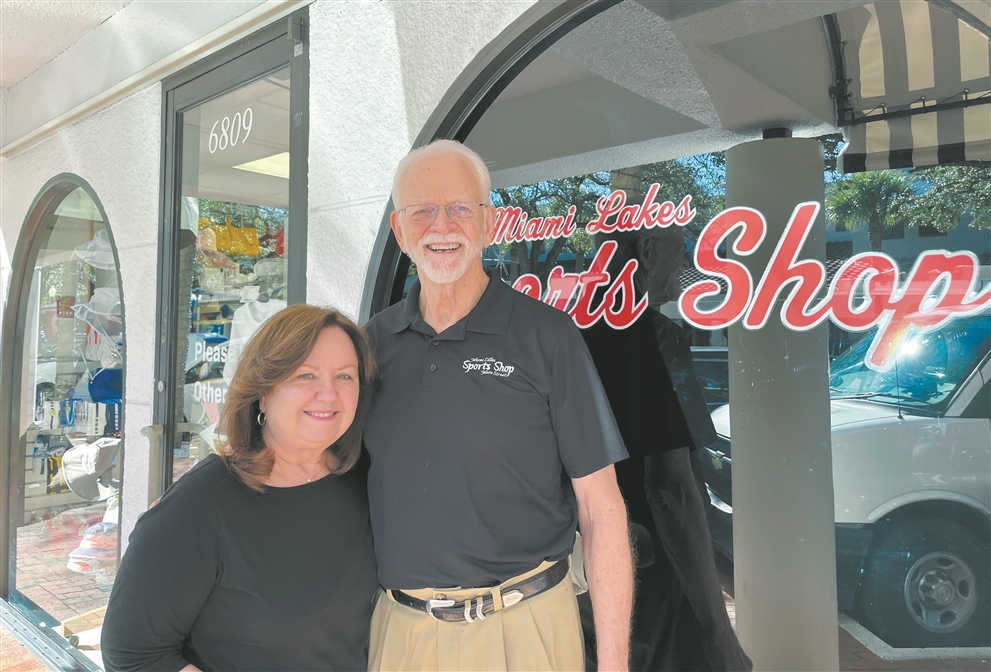 Rosalyn and Jim Hamilton, owners of the Miami Lakes Sports Shop, outside of their business at 6811 Main St. in Miami Lakes. Photo by Linda Trischitta.