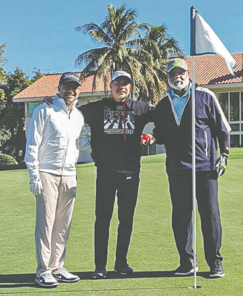 A great day at The Senator Course at Don Shula's Golf Course: left to right, Elvin Jimenez, Rubin Jimenenz and Flen D. Mobley, celebrate Mobley making a hole-in-one on Jan. 29. Mobley is holding the ball that went into the cup on Hole 3. Photo by Ros